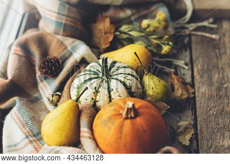 Happy Thanksgiving. Stylish Pumpkins, Autumn Leaves, Pears And Cozy Scarf On Rustic Old Wooden Backg