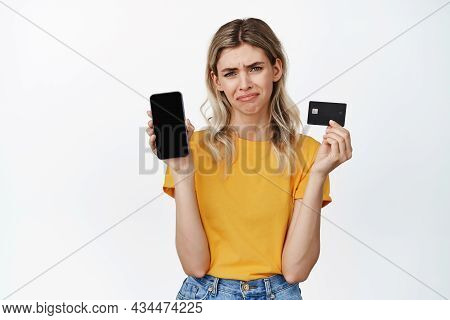 Crying Girl Showing Empty Mobile Phone Screen And Credit Card, Sulking Disappointed, Cannot Buy Some