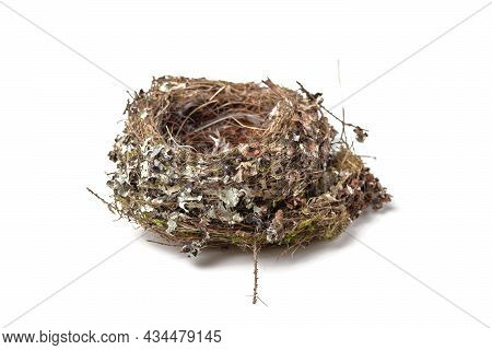 Empty Bird Nest Made Of Straw, Sticks And Feathers Isolated On White Background, Side View, Soft Foc