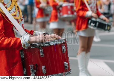 Young Girls Drummer At The Parade. Street Performance. Majorettes In The Parade