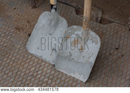 Close-up On Two Construction Shovels. Construction Tool.