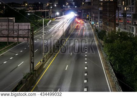 Long Exposure Of Highway In Nyc. The Light Trails On The Road At Night