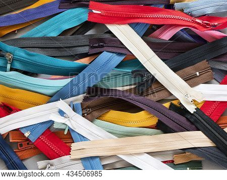 Multicolored Zip Fasteners For Garment Or Accessories Making. Many Zippers Of Different Types: Coil,