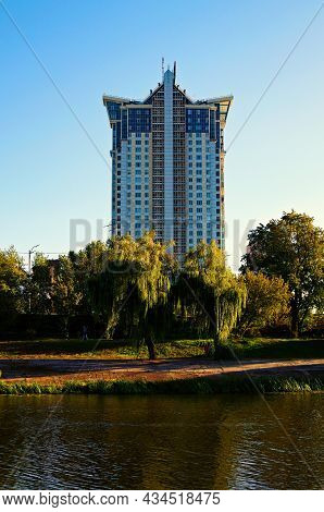 Modern High-rise Residential Building Against Blue Sky. Concept Of Modern Architecture From Glass, S