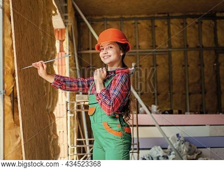 Industry. Kid In Workshop Training To Use Hand Instrument. Girl Wearing Engineer Clothes. Tools To I