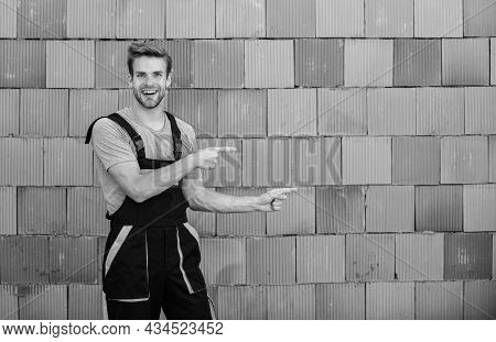 Worker Brick Wall Background. Building Construction. Man Build House. Inspecting Building. General M