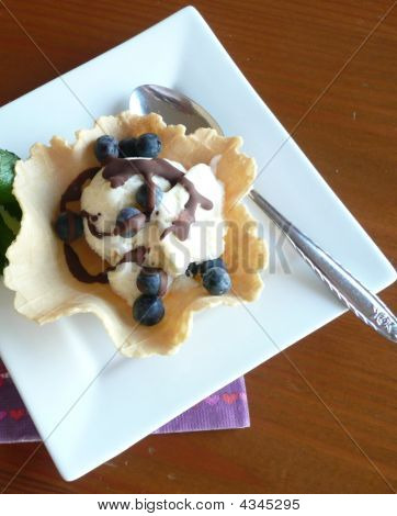 Blueberries With Chocolate Topping On Ice Cream
