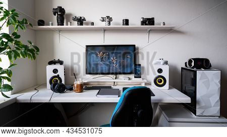 Front View Comfortable Home Office Workplace Of Photographer With Computer, Camera Lens