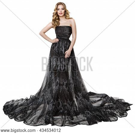 Fashion Model In Long Black Dress. Stylish Woman With Perfect Curly Hairstyle And Make Up In Sparkli