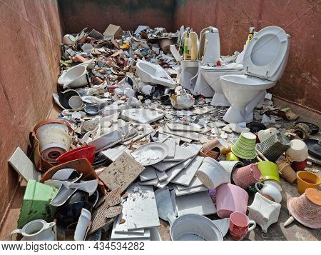 Ceramic Trash In A Recycling Container. Broken Toilet Seats, Kitchen Ceramic Ware, Broken Cups And P