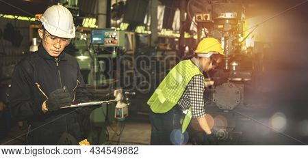 Male Engineer Foreman Inspects The Machine Parts That The Female Worker Technician Has Built, Prelim