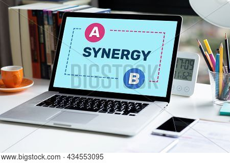 Synergy And Connection Of Business With Text On Laptop.partnerships Or Cooperation To Success.no Peo