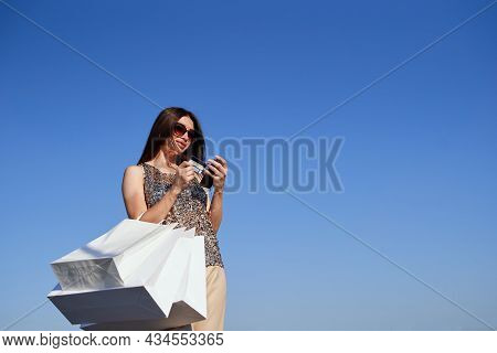 Sale, Consumerism, Online Shopping Or Black Friday Concept. Portrait Of Cheerful Caucasian Fashion S