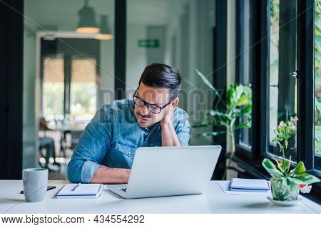Businessman Office Working Holding Sore Neck Pain From Desk Working And Sitting All Day Using Laptop