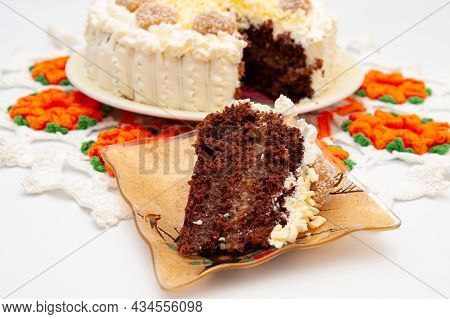 Sliced Piece Of Delicious Homemade Chocolate Cake Decorated With Grated White Chocolate And Dulce De