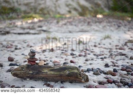 Balanced Pebbles Pyramid On The Beach. Zen Stones On Sea Beach