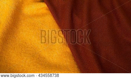 Background From Yellow And Burgundy Silk Fabric. Textile, Copy Space From Silk Fabric. Background Fo