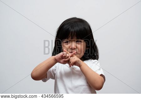 Portrait Of Asian Angry, Sad And Cry Little Girl On White Isolated Background, The Emotion Of A Chil