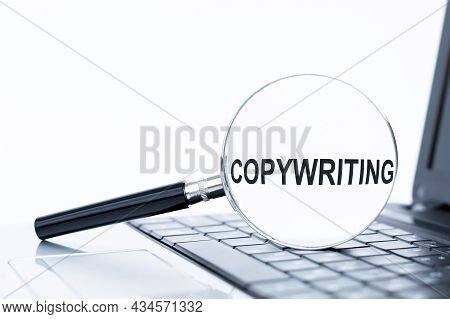 Copywriting Word On A Magnifier That Lies On A Laptop, Business Concept