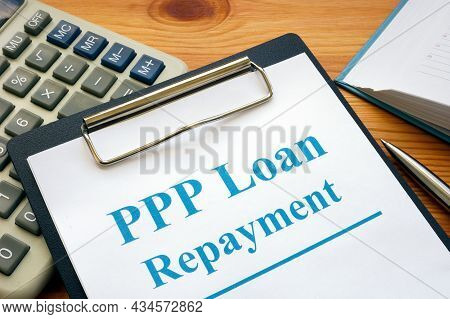 Ppp Loan Repayment Form And Clipboard With Calculator.