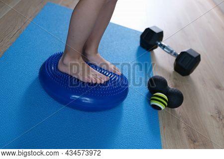 Children Feet Standing On Balancing Orthopedic Pillow In Rehabilitation Center Closeup