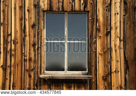 Old Weathered Wooden Exterior Barn Window With Vertical Plank Siding