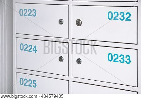 Bank Cells With Numbers. Metal Deposit Boxes For Temporary Storage. Row Of Safes In A Bank Vault.