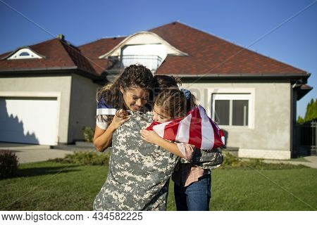 Soldier In Uniform Coming Home And His Lovely Family With American Flag Running Into His Arms Celebr
