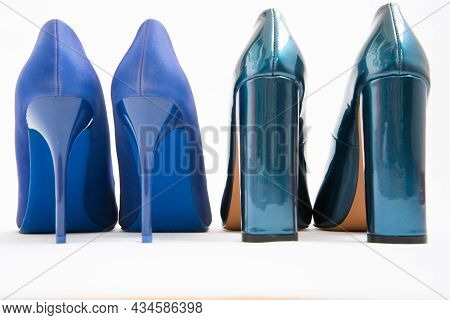 Two Pairs Of Blue Womens Shoes. High-heeled Shoes. One Pair Of Thin Heels, Stiletto Heels. The Secon