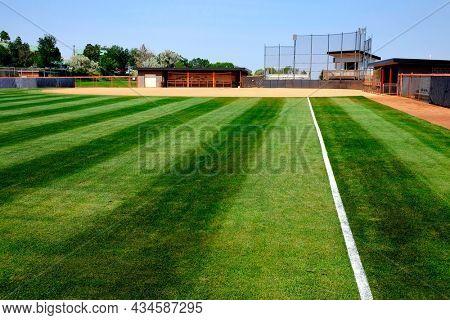 Ball diamond plarying field baseball with manicured mowed grass