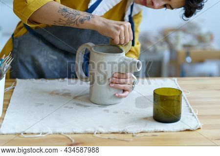 Pottery Hobby Or Ceramic Manufacturing Small Business Concept With Young Female Artist Molding Jug O