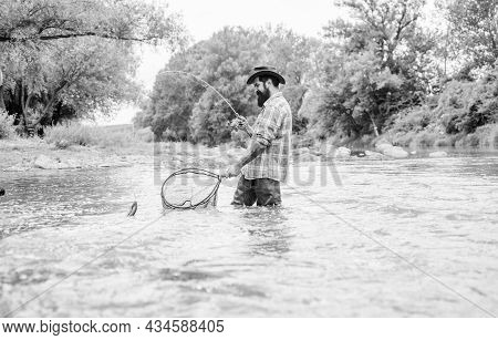 Fishing Provides That Connection With Whole Living World. Find Peace Of Mind. Bearded Fisher Catchin