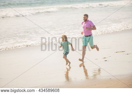 Fathers Or Family Day. Daddy With Kid Boy On Summer Day. Dad And Child Having Fun Outdoors.