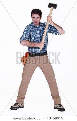 furious craftsman holding a hammer