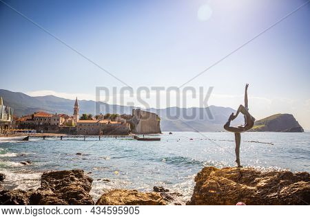 Budva, Montenegro - September 18, 2021: Statue Of A Dancer On The Background Of Old Town Budva, Mont