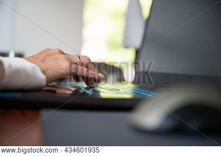 Low Angle View Of A Female Hand Typing On Laptop Computer.