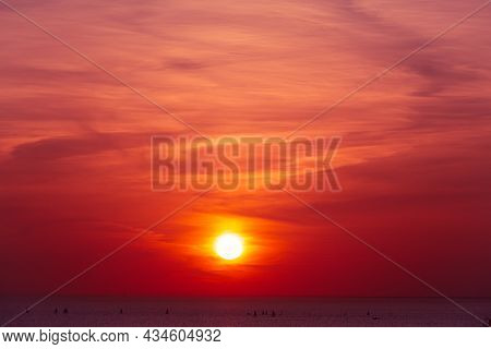 Stunning Sunset At Gulf Of Finland In Saint Petersburg. Sun Disc Over The Horizon. Bright Backlit Sk