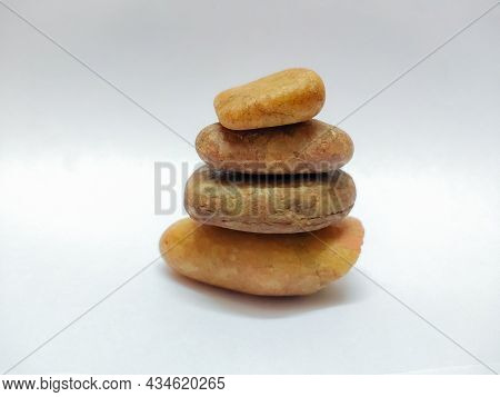 Closeup Of Meditation Stones Stacked On Top Like A Pyramid In A Isolated White Background With Selec