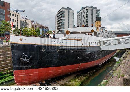Belfast, N.ireland- Sept 4, 2021: The Nomadic Cherbough Boat Near The Titanic Museum  In Belfast Cit