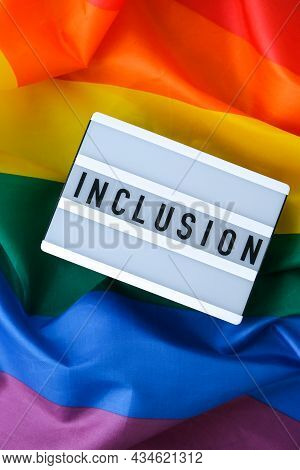 Rainbow Flag With Lightbox And Text Inclusion. Rainbow Lgbtq Flag Made From Silk Material. Symbol Of