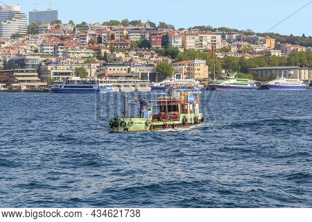 Istanbul, Turkey - September 12, 2017: A Small Tugboat Moves Along The Bosphorus Strait Near The Bes