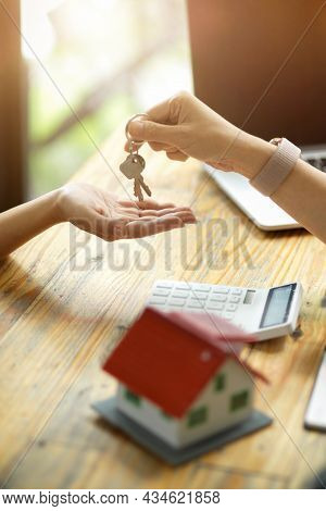 Real Estate Realtor Or Broker Giving A House Keys To New Owner