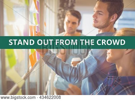 Composition of stand out from the crowd text over businesspeople taking notes. business and template concept digitally generated image.