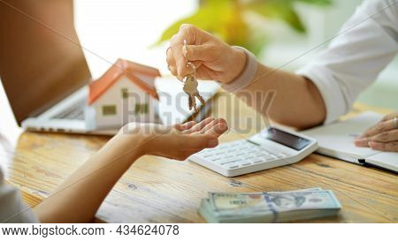 Real Estate Agent Giving A House Keys To New Buyer