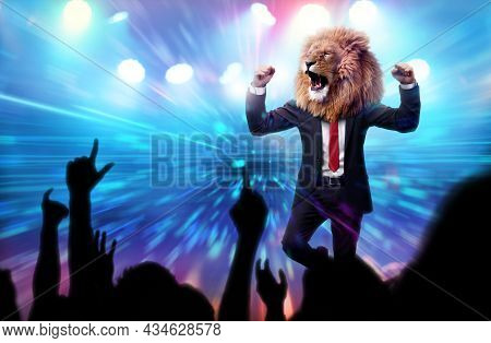 Man With A Lion Head In A Business Suit Celebrating In A Victory Party With Crowd Cheering. Business