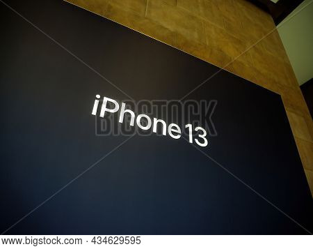 Paris, France - Sep 24, 2021: Large Poster Of Iphone 13 At The Apple Store As Latest New 5g Iphone 1