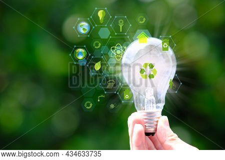 Energy Saving Light Bulb And Save World Concept, Sustainable Development. Ecology Concept, Green Ene