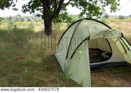 Outdoor Camping With Tent In Summer Forest. Tent In The Summer Forest. Rest At Nature