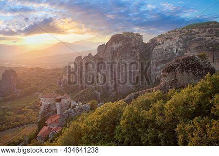 Beautiful Sunset In Greece. Meteora Rocks, Kalampaka, Monastery And Sunset Sky Clouds