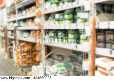 Hardware Construction Supermarket Aisle And Shelves With Tile Adhesives, Tile Grout And Other Tile M